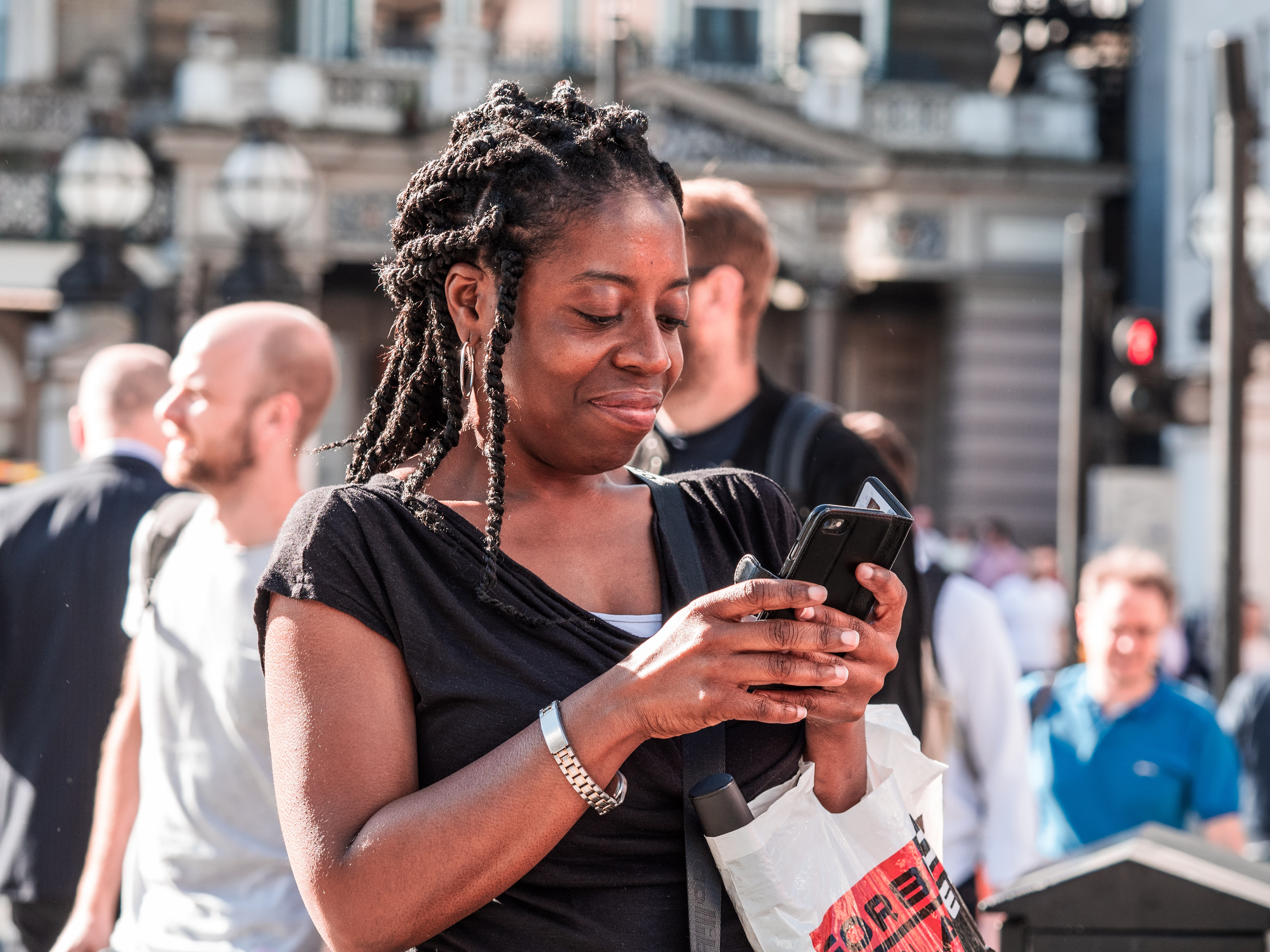 Woman smiling and looking at phone