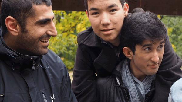 Kaveh Pakjoo with two teens he works with